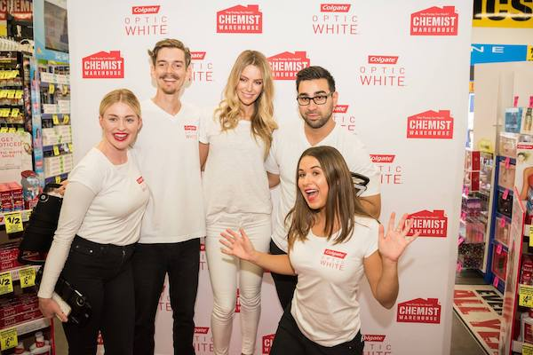 people posing in photo booth at event activation
