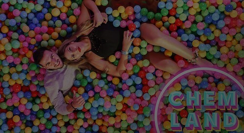 guy and girl in ball pit at aerial photo booth event