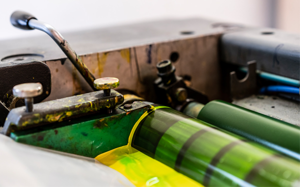 Lithographic print machine with inked rollers in Watford print factory