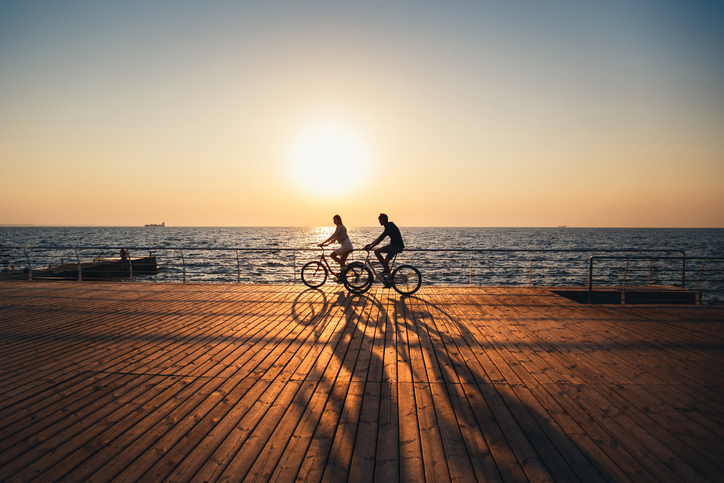 couple riding bike on vacation