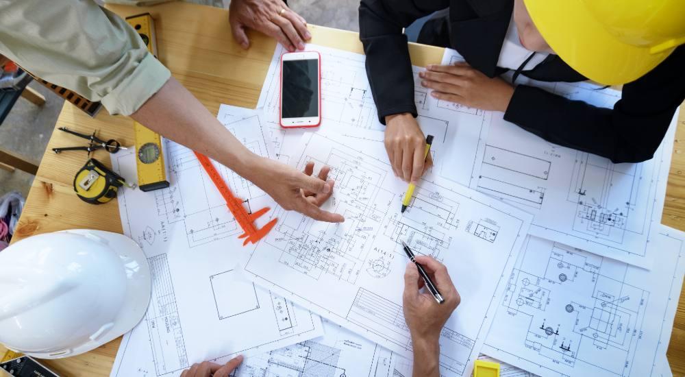 building contractors discussing construction plans on site
