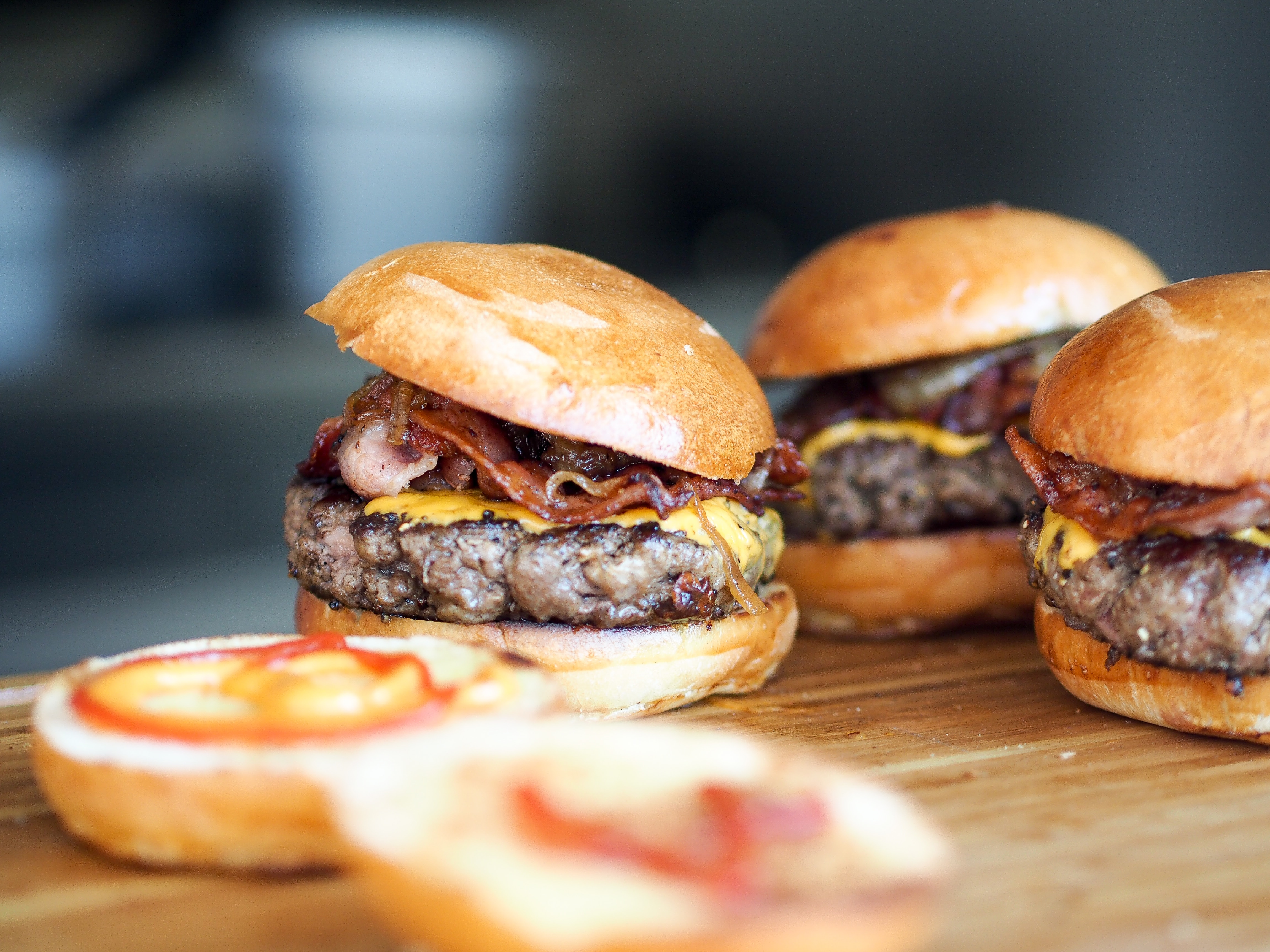 Three bacon cheeseburgers