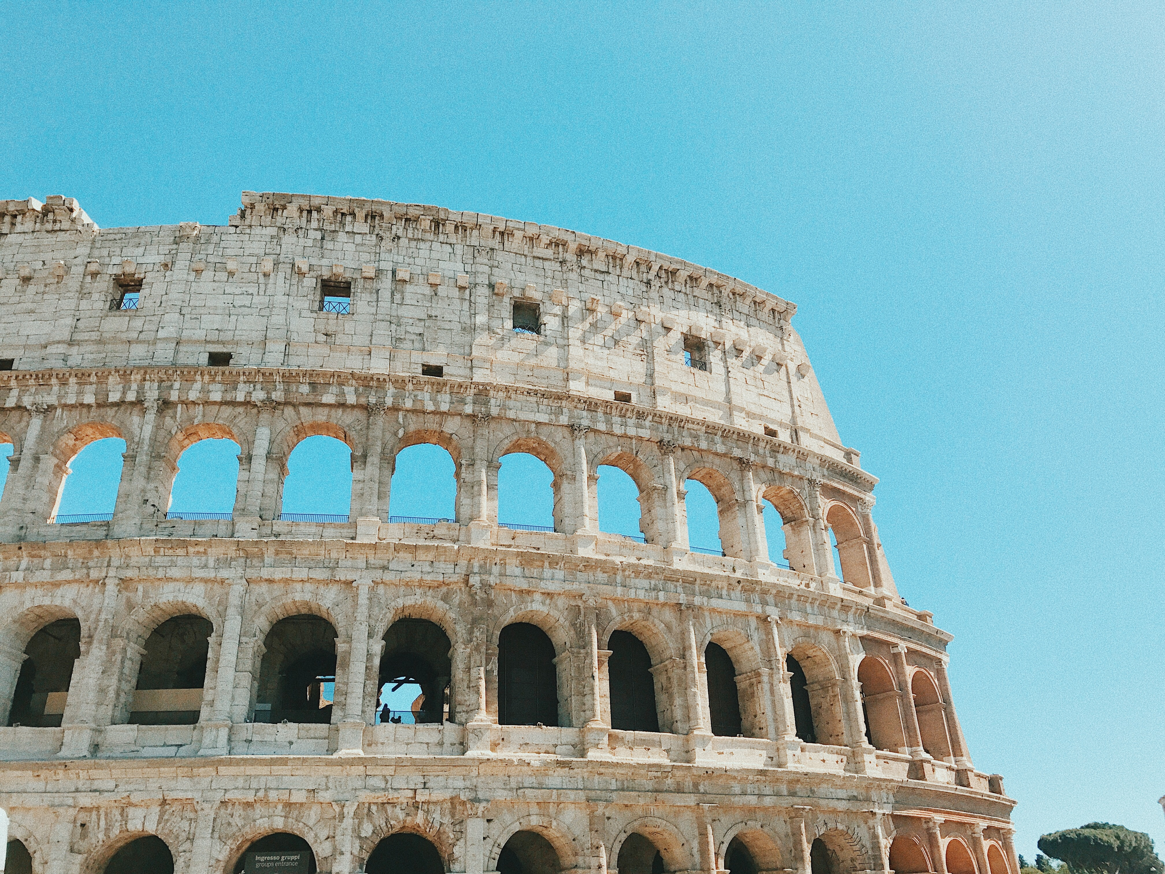 Roman coliseum with blue sky background