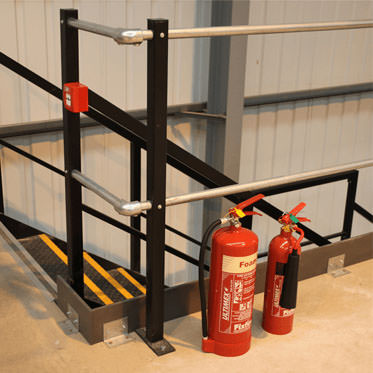 Photo of extinguisher stands on the floor