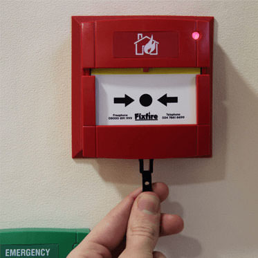 Photo of a Fire Alarm Test using Resettable Call Point