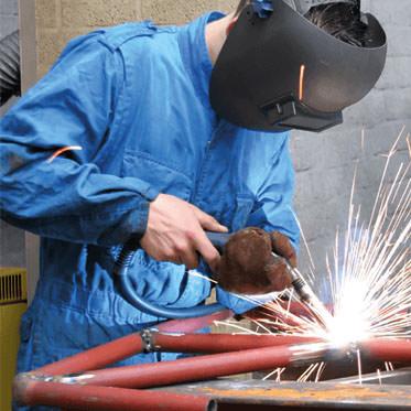 Photo of a man welding