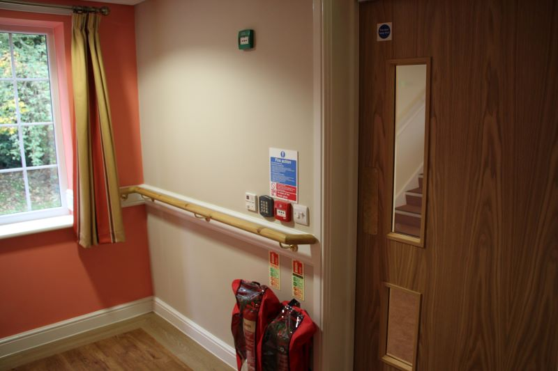 CareEntri™ Monitored Access Control System to door leading to stairs