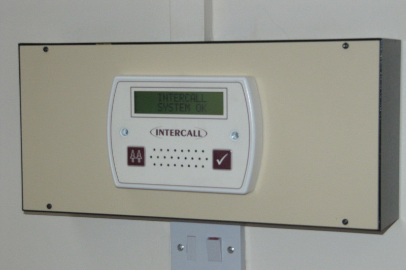 Nurse Call System- CareAlert 600 Nurse Call Display Unit mounted to original call system back box via conversion plate