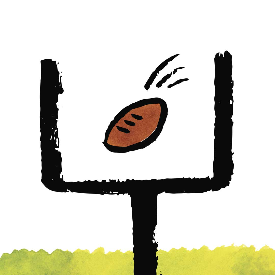 Football going through the uprights of a goal post
