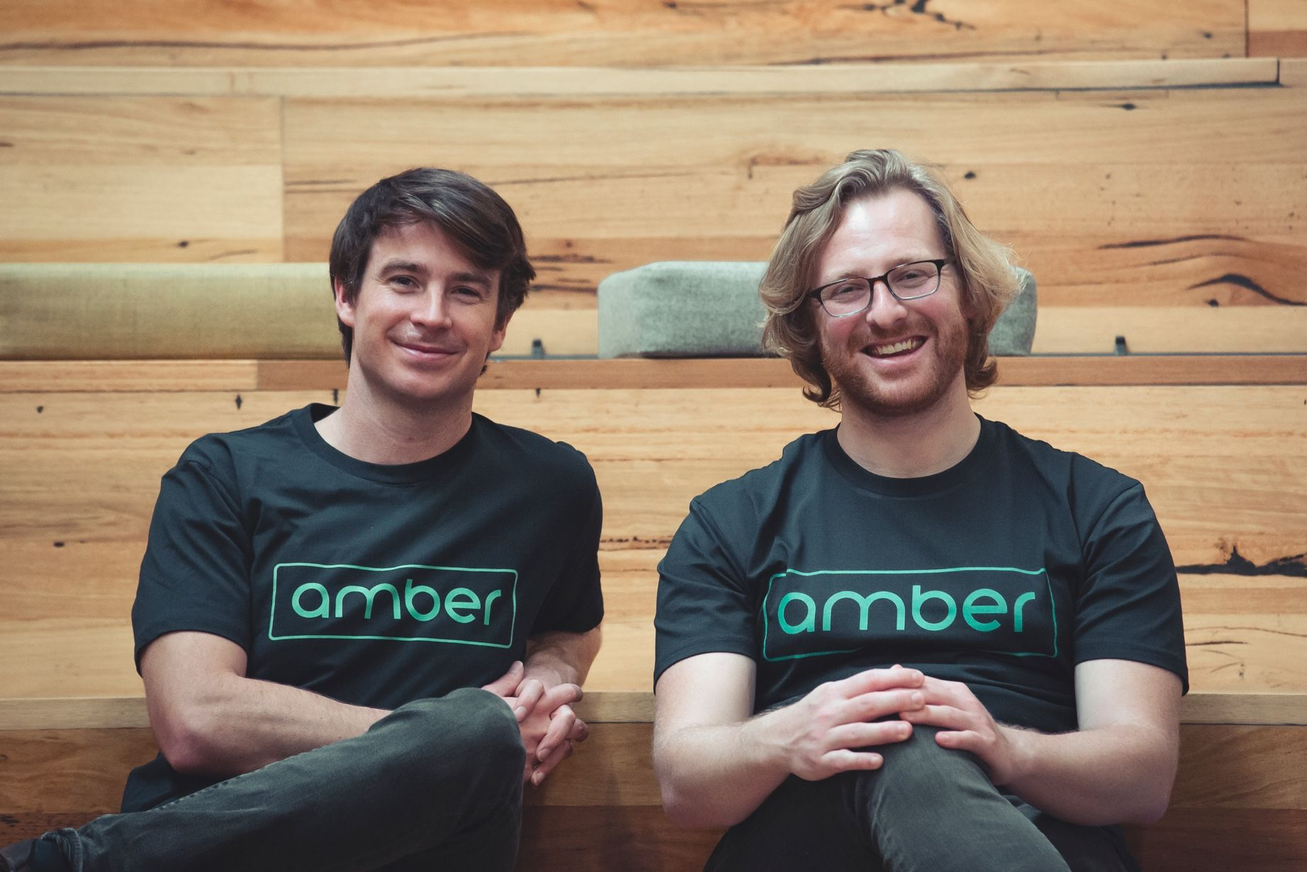 Co-Founders of Amber Electric, Chris and Dan sitting next to each other.