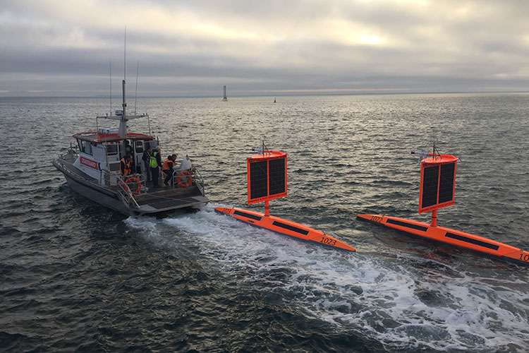 Saildrones towed out for deployment
