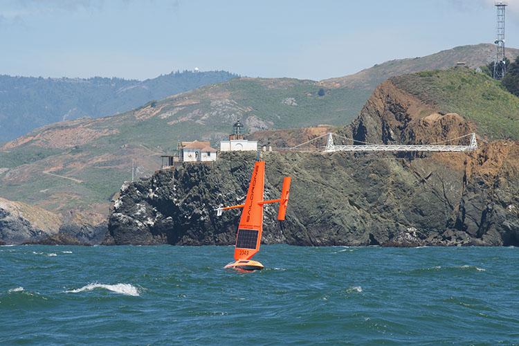 Saildrone sailing in the Pacific Ocean near Point Bonita lighthouse