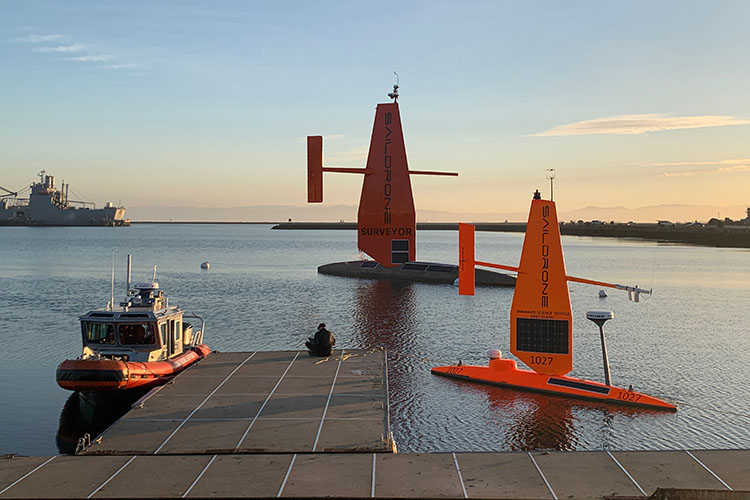 Saildrone Surveyor with Saildrone Explorer and Saildrone Support in Seaplane Lagoon.