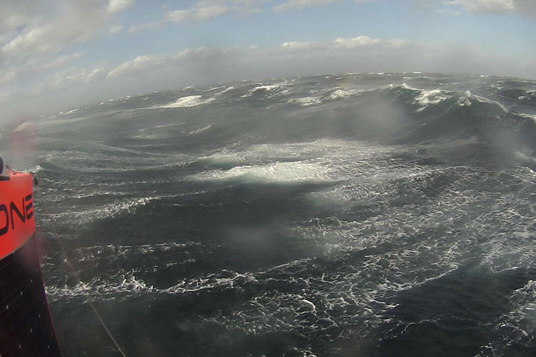 A saildrone sailing in storm conditions in the Southern Ocean.