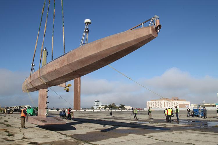 Saildrone Surveyor hull on crane