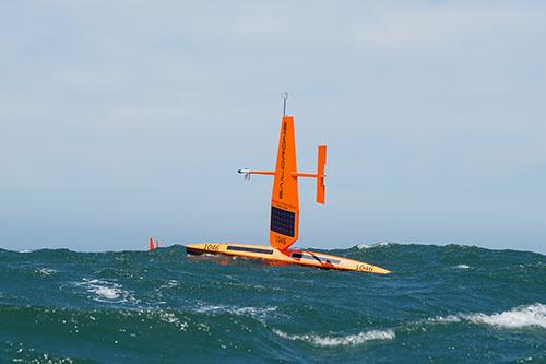 Saildrone Explorer in Pacific Ocean waves.