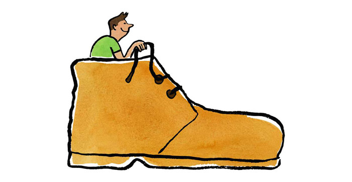 Illustration of a man sitting in a giant shoe