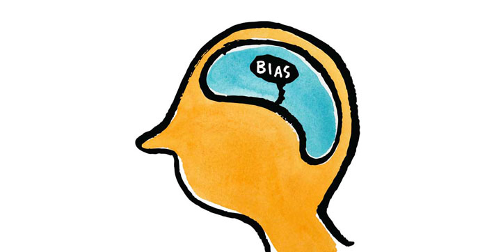 Illustration of a head with the the brain showing and the word Bias in the middle
