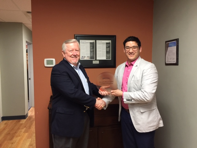 Gary Crouch and Juston Michealson holding the acuatica gold certified partner award 2018