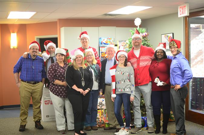 CS3 Technology Staff standing together in front of their Toys for Tots Donation
