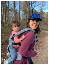 Toddler in a secure harness on mom's back while they are hiking
