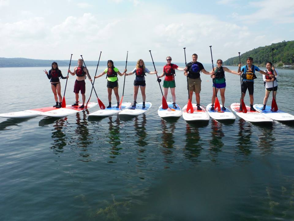 group of stand-up paddleboarders