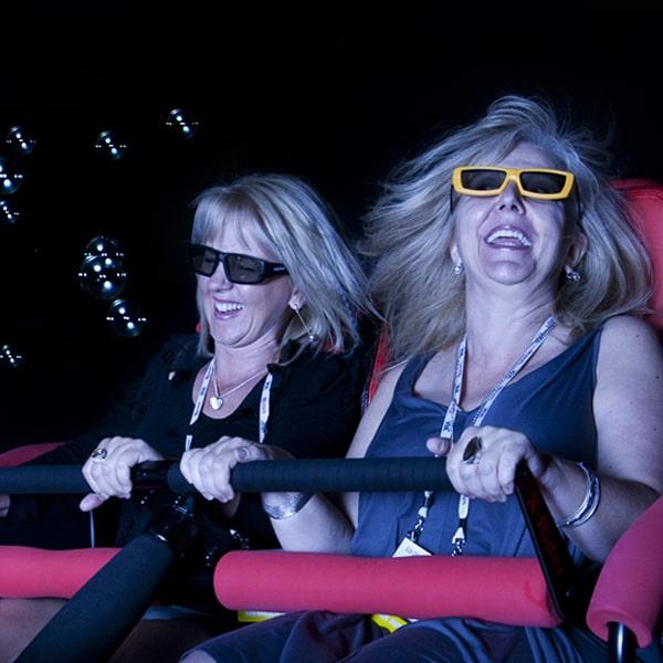women similing on 4D Motion Simulator