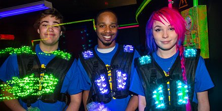 happy teens playing laser tag