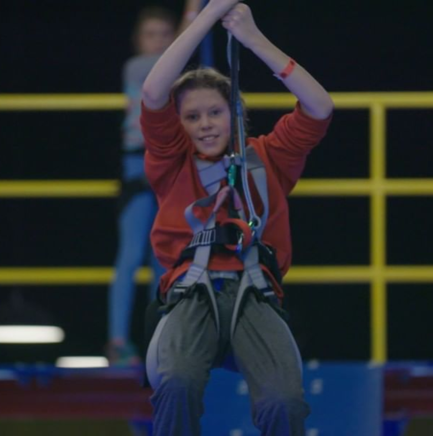 happy boy on ropes course