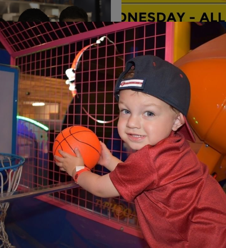 small child holding toy basketball