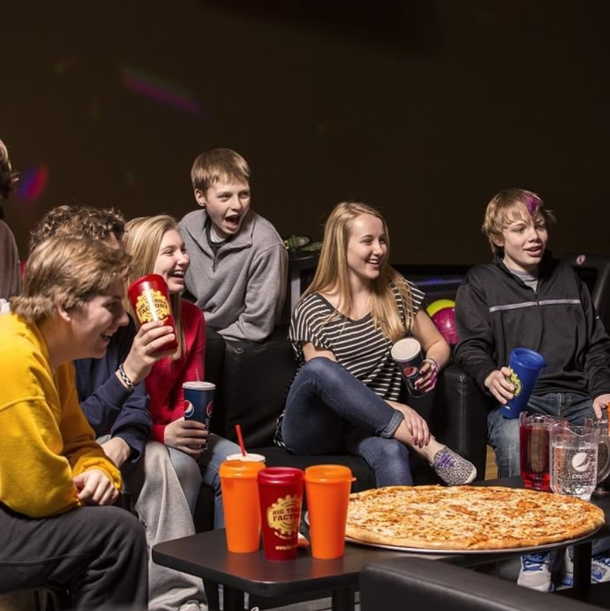 group of happy teens with pizza and soda