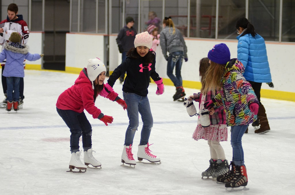 group of girls learning to ice skate