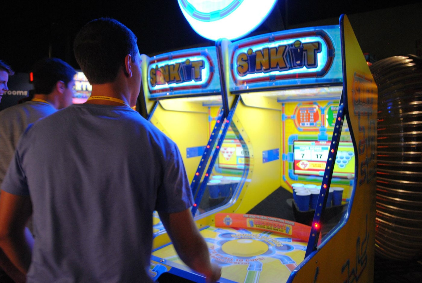 adult playing arcade game