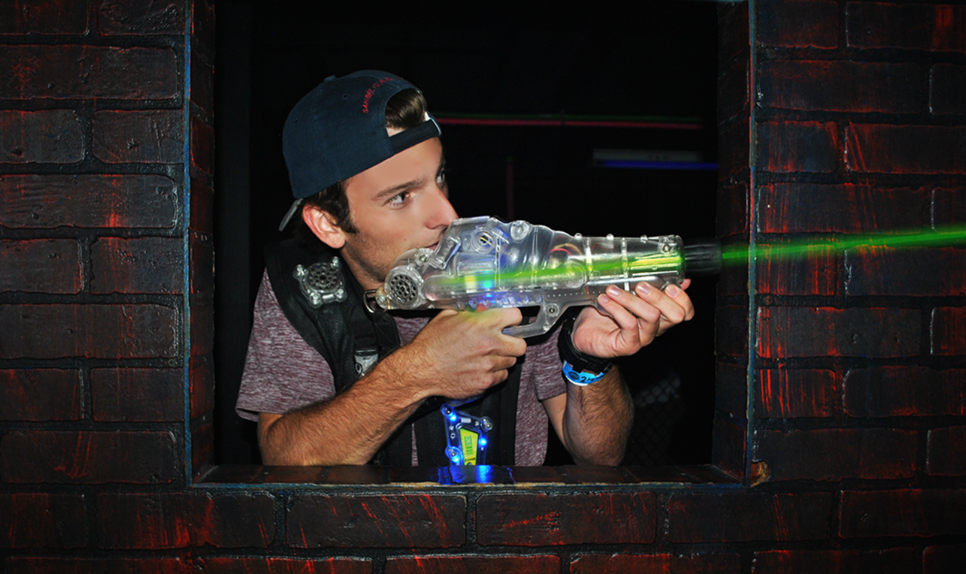 young adult playing laser tag