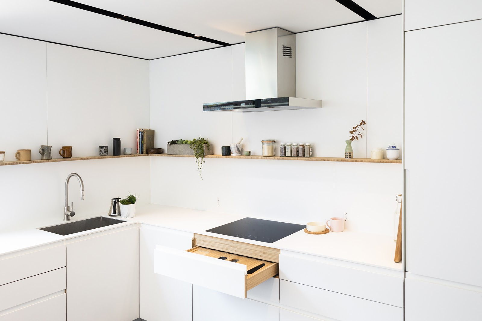 Cover's bamboo kitchen cabinetry finished with a white solid surface material