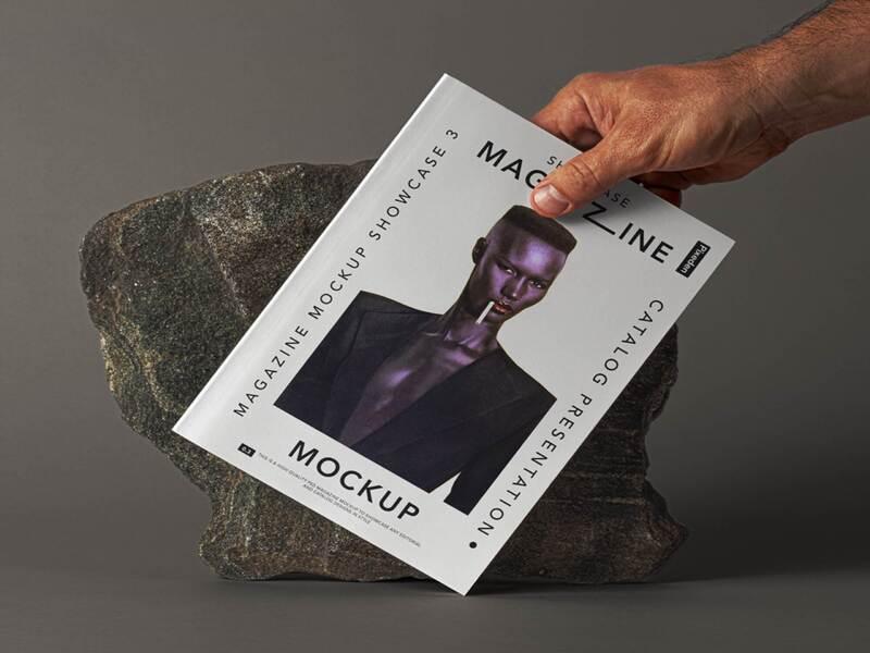 A Hand Holding Magazine Mockup