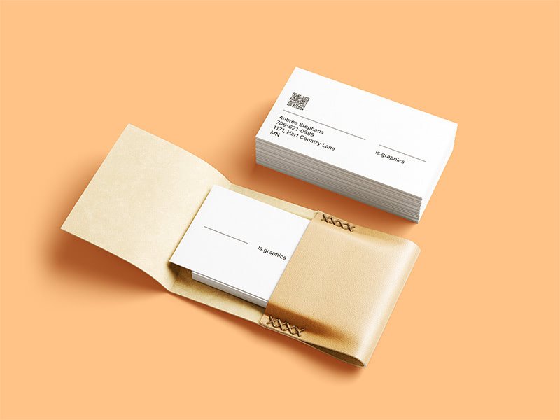 This beautiful mockup features 2 stacks of business cards as well as an elegant handmade leather cardholder that makes the scene look more stylish and photorealistic. Great for your personal and commercial brand presentations.