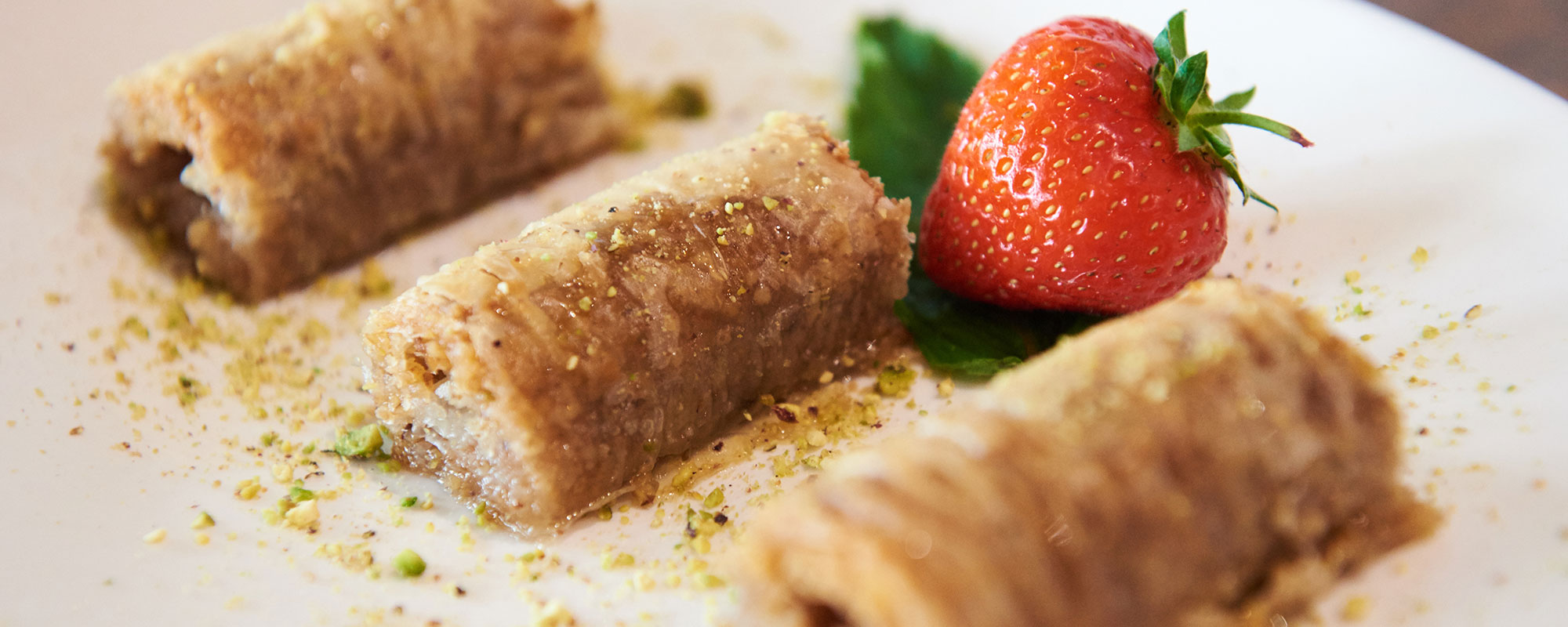 Liman restaurant image of Mediterranean food on plate with strawberry
