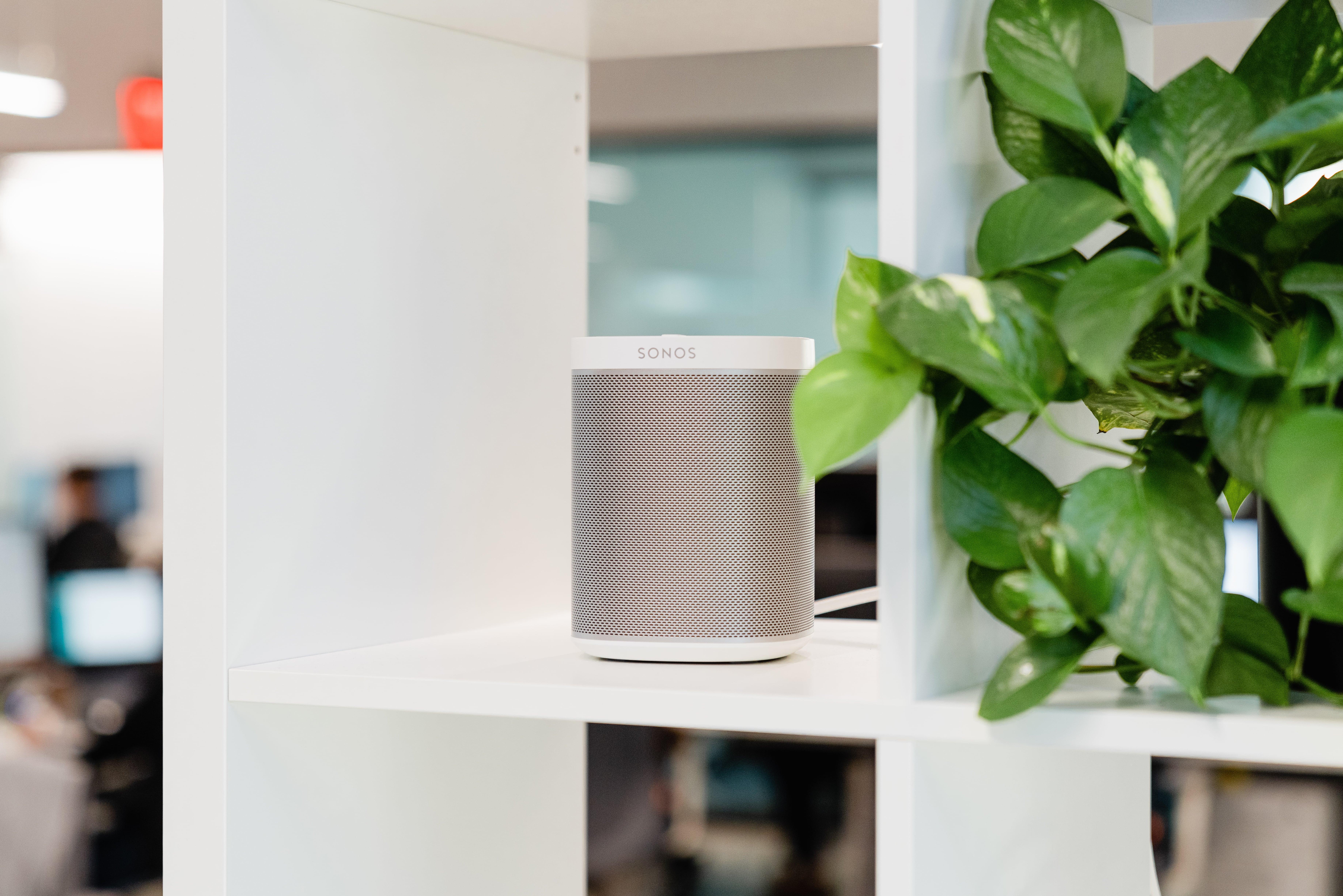 White Sonos speaker on an office shelf