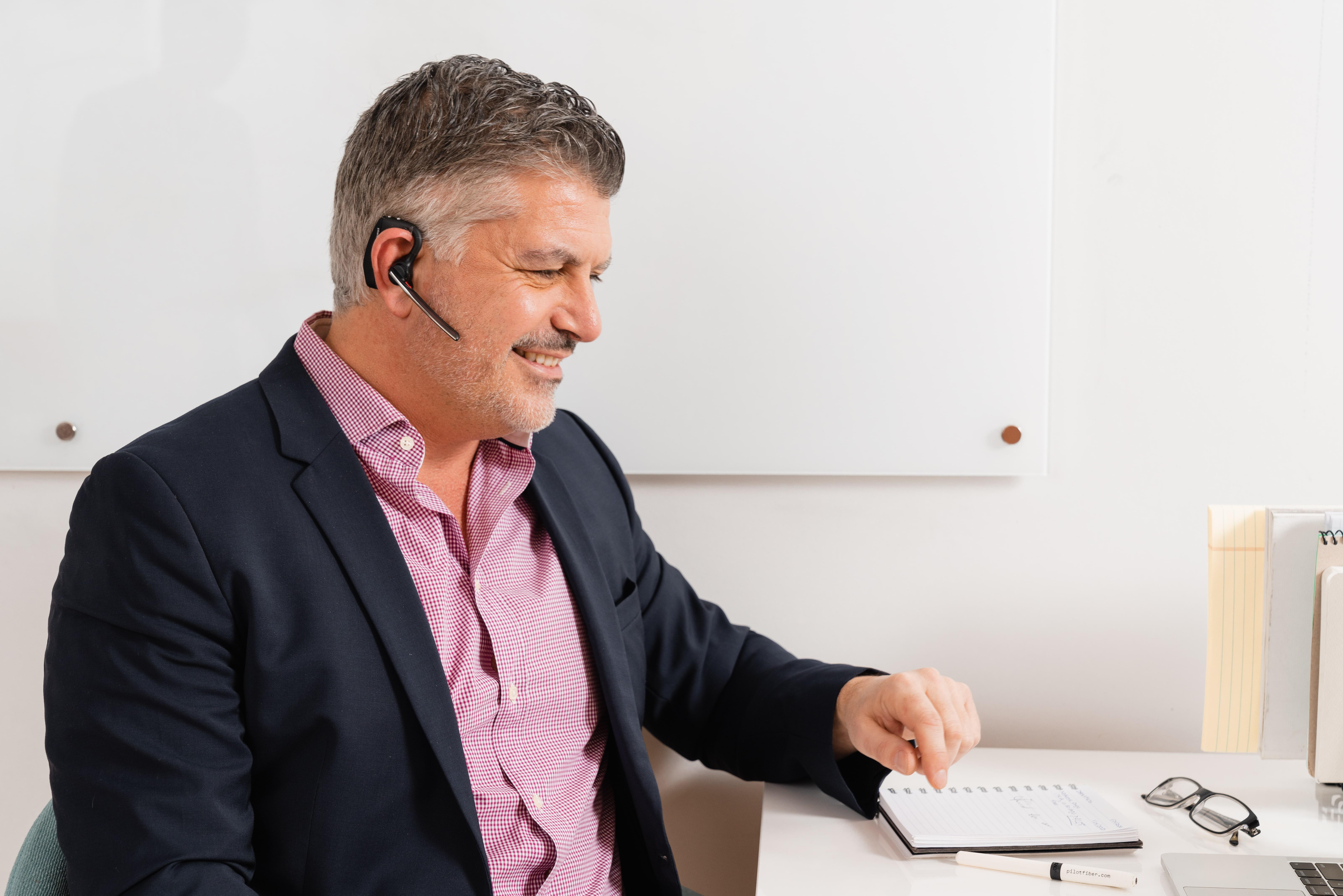Man on a phone call wearing wireless headphones
