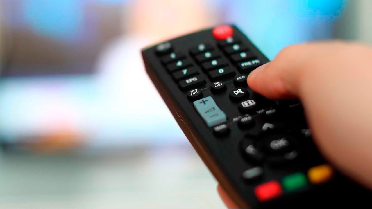 TV remote held in hand