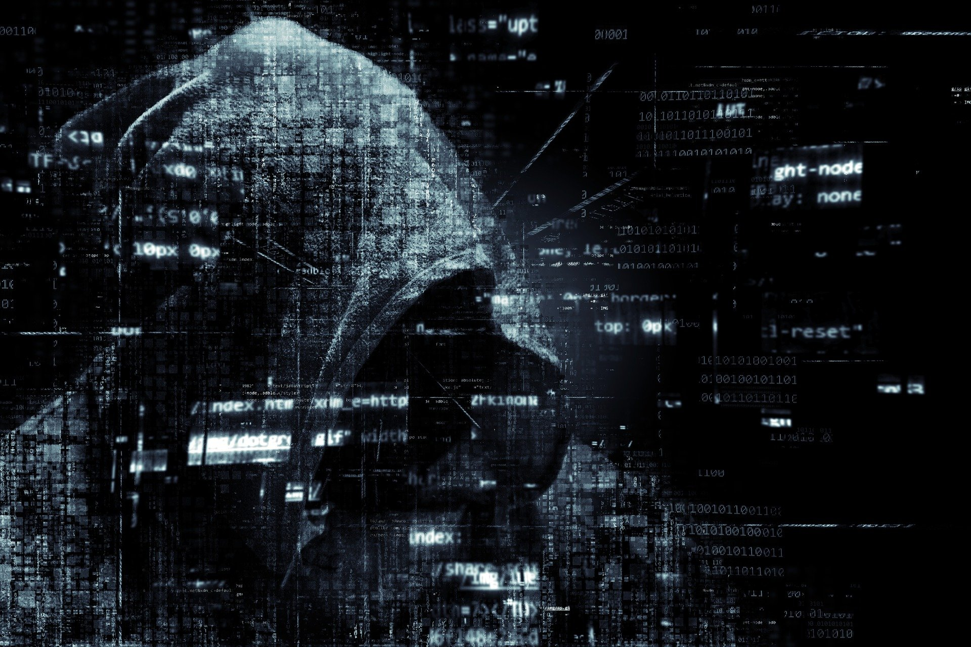 hacker in front of computer coding