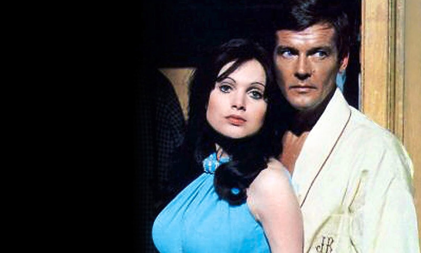 Actress Madeline Smith and Roger Moore as James Bond