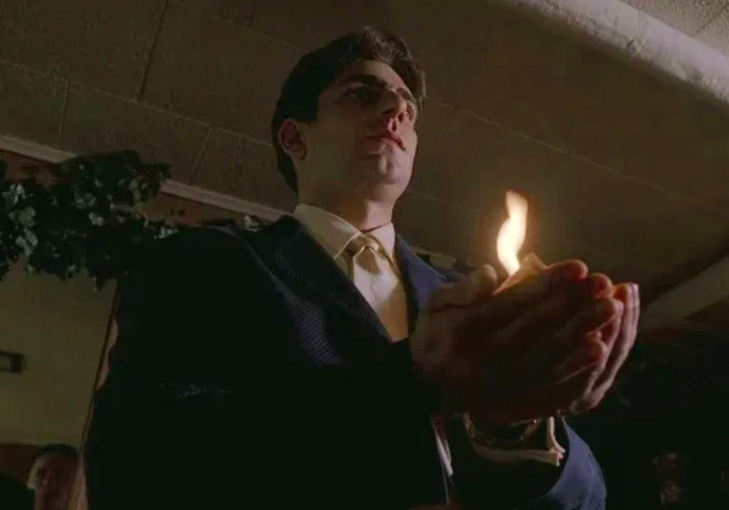 Christopher Moltisanti (Michael Imperioli) swears an oath to Tony Soprano