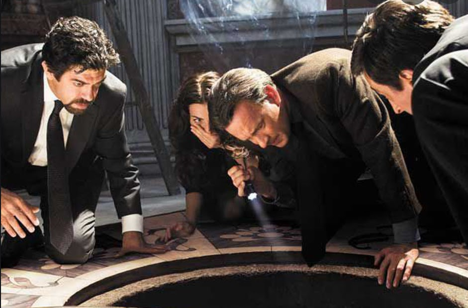 Tom Hanks (center) reprises his role as Robert Langdon in Angels & Demons