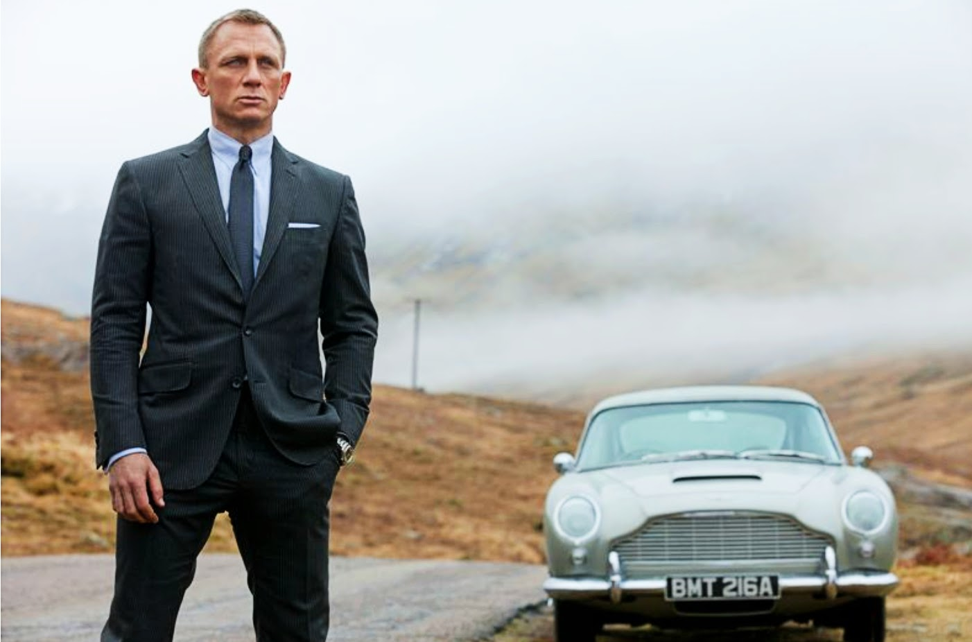 Daniel Craig with his DB5 in Skyfall