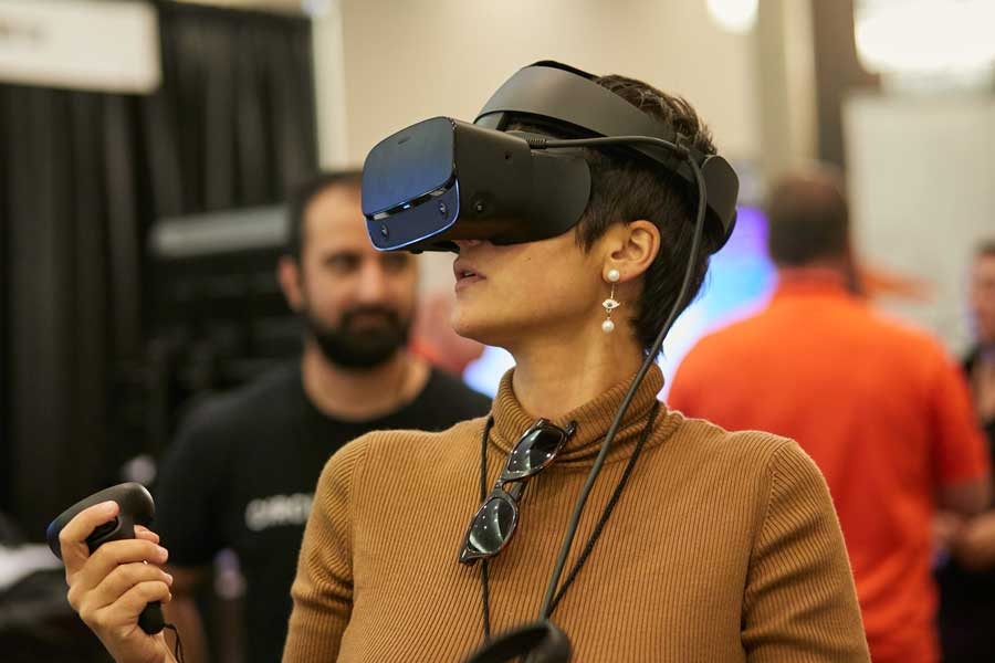 EWTS 2019 Woman with Oculus Rift at Circuit Stream booth