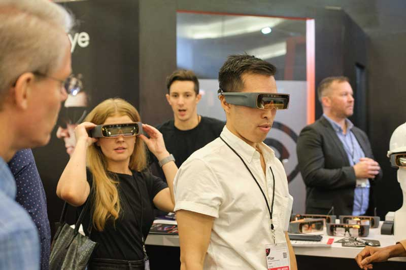 several end users try on the Thirdeye X2 mixed reality glasses at EWTS 2019