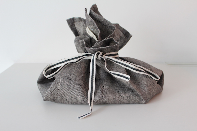 Image of a tea-towel wrapped gift.