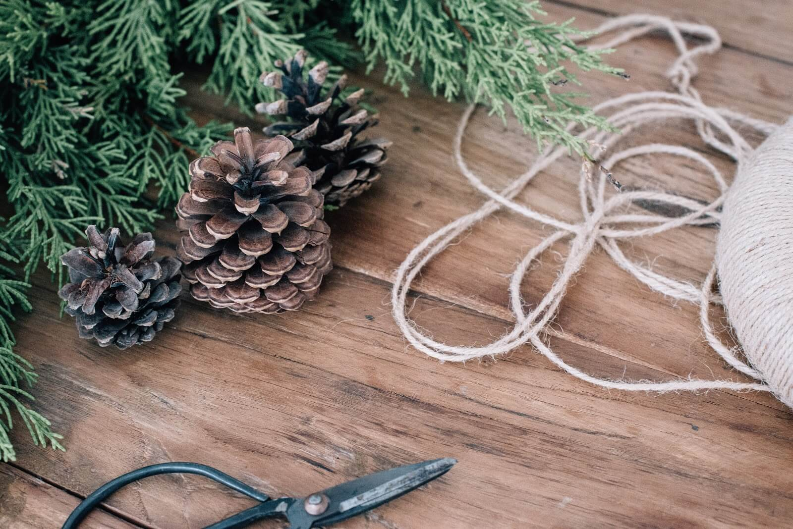 Natural or recycled wreaths, driftwood ornaments, decorated pine cones, and snowflakes made out of sticks.